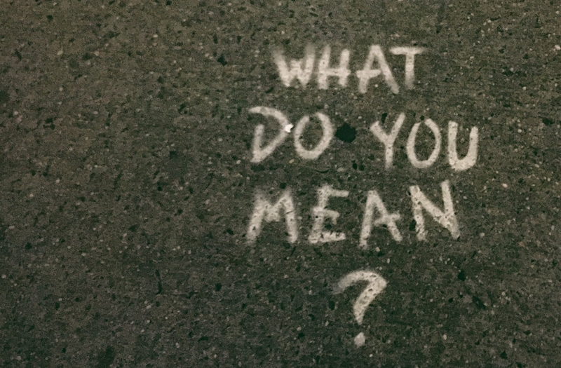 image with words what do you mean written in chalk